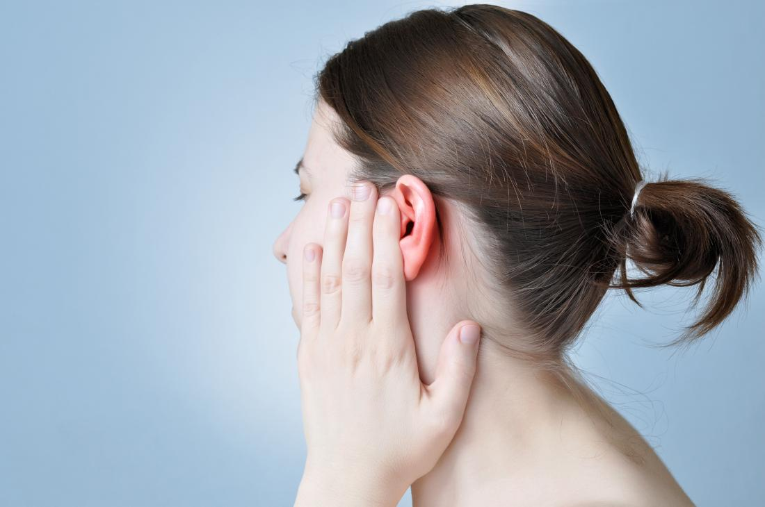 woman-covering-her-ear-in-pain